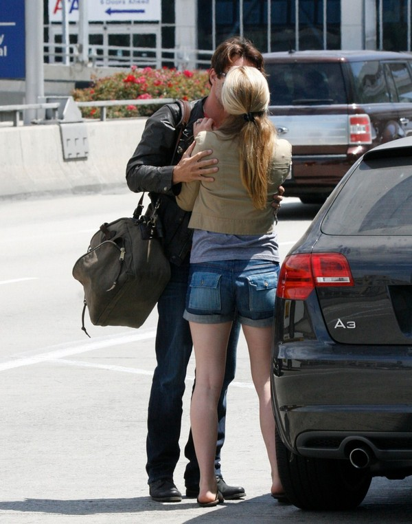 Anna Paquin in Jean Shorts at LAX Airport - July 31, 2011