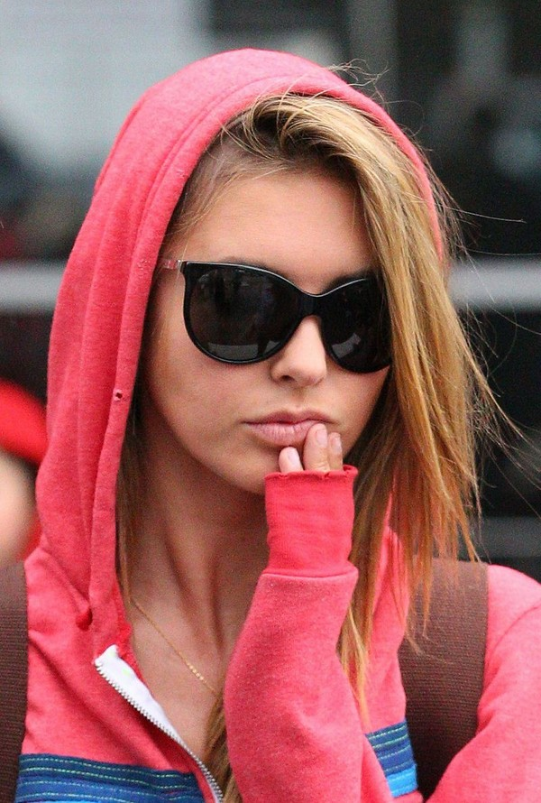 Audrina Patridge in the rain at Melbourne International Airport - July 13, 2011