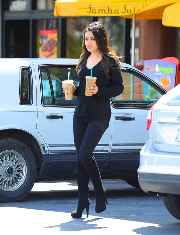 Mila Kunis makes a pit stop for two ice coffees in Los Angeles