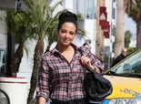 Tulisa Contostavlos arrives for a meeting in Hollywood on March 20, 2013