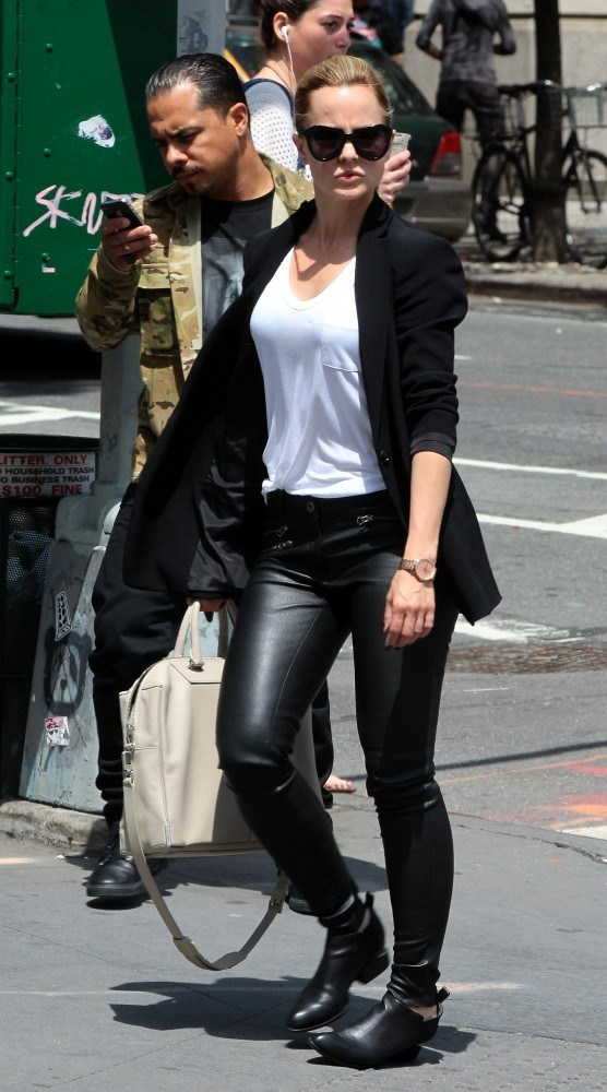 Mena Suvari in leather pants, out and about in Soho on May 16, 2013