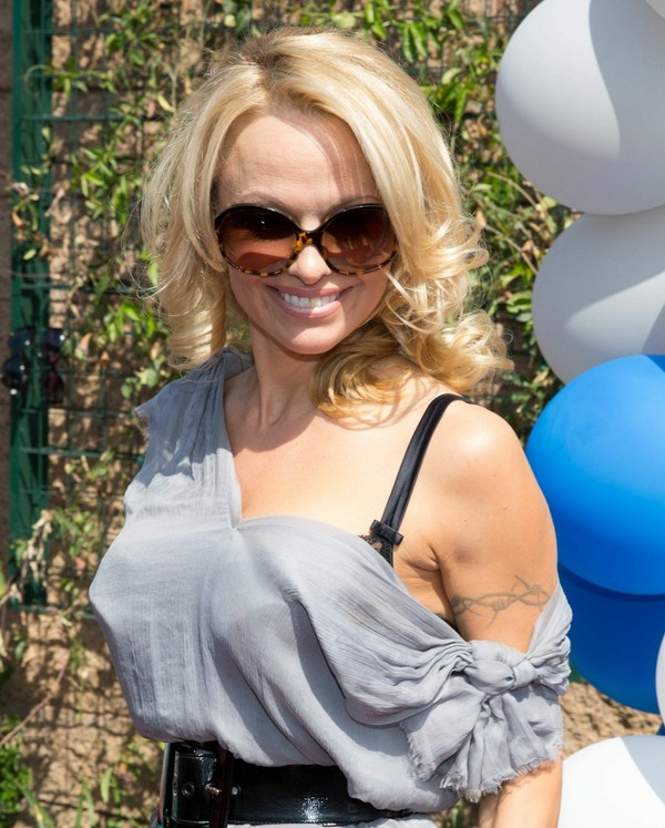 Pamela Anderson arrives at the Sapphire Pool & Day Club Grand Opening Party in Las Vegas on May 4, 2013