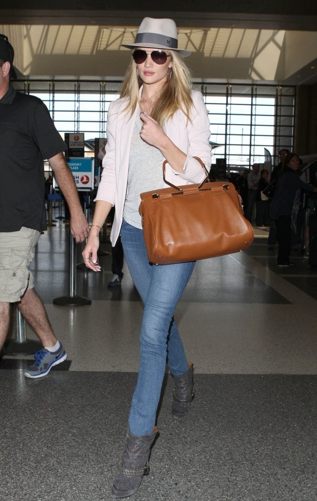 Rosie Huntington-Whiteley departing on a flight at LAX on May 17, 2013
