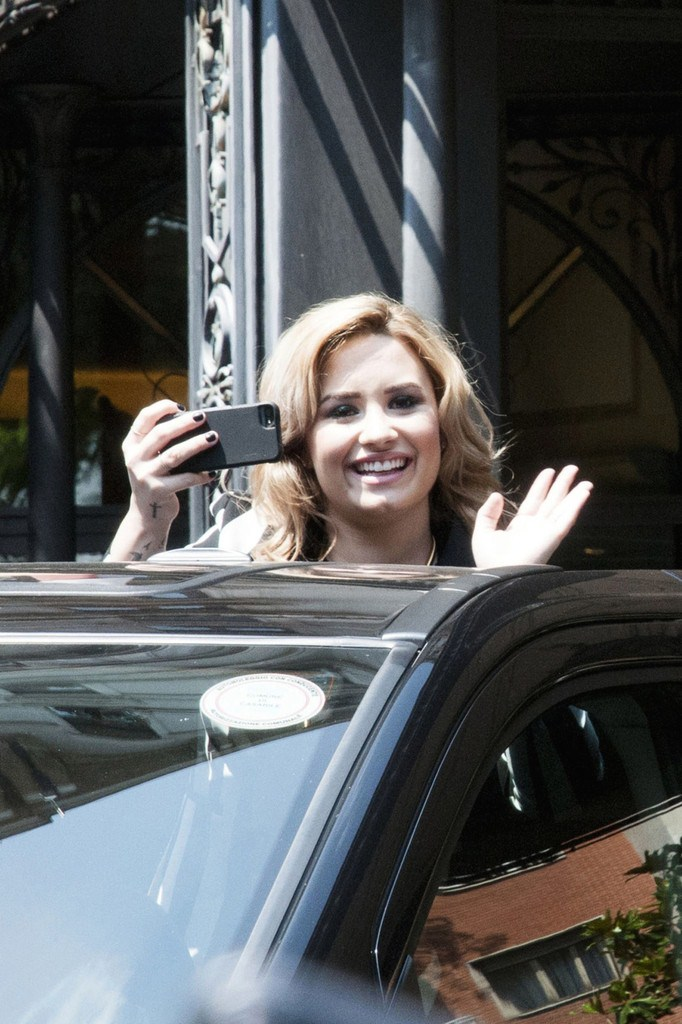 Demi Lovato Leaving her Hotel, waving to her fans in Milan on June 5, 2013